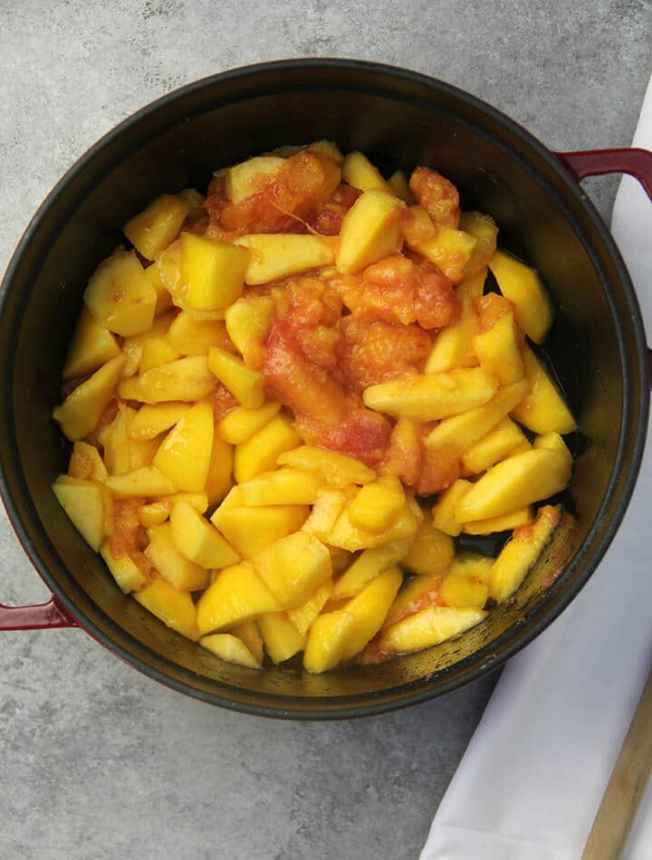 Peaches in a pot to make peach cobbler.