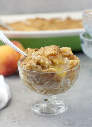 Serving of peach cobbler in a bowl.