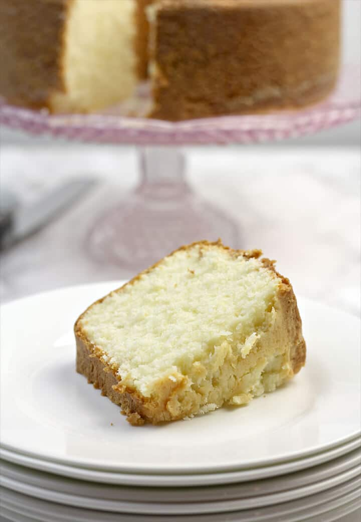 Slice of Cream Cheese Pound Cake on a plate with the cake stand.
