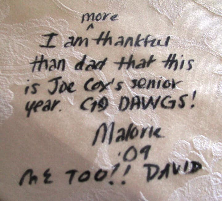 A photo of a quote on the tablecloth, a great diy Thanksgiving decoration.