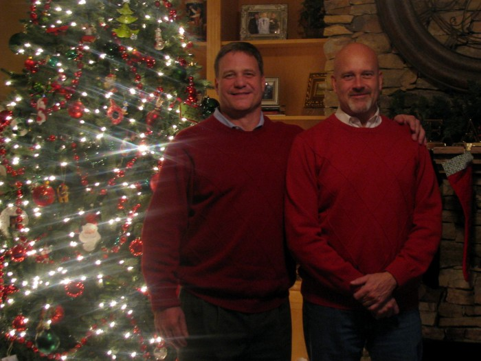 Husbands in unplanned matching sweaters.