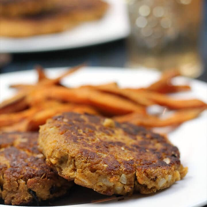 Cooked salmon patties on a plate.