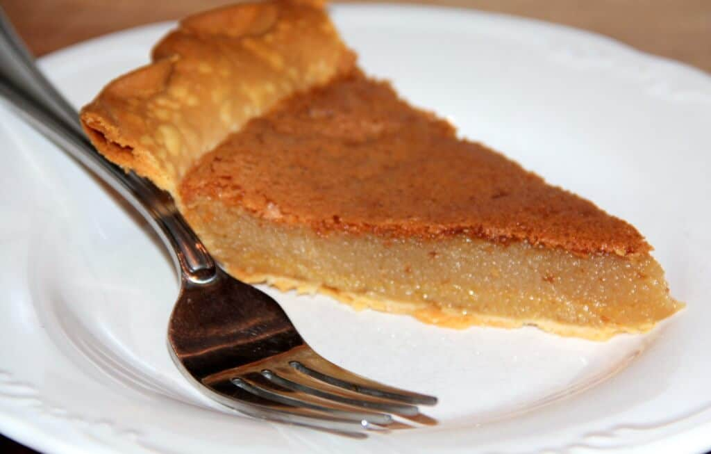 slice of chess pie on a plate with a fork