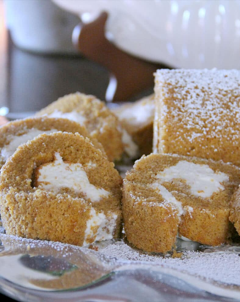 Slices of pumpkin roll on a plate.