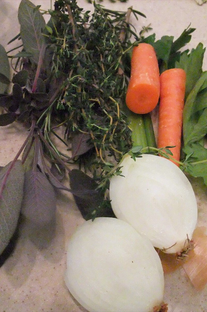 Fresh herbs, onions, and carrots to stuff inside the cavity of the turkey.