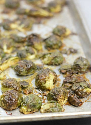 Roasted Brussels Sprouts closeup on a baking sheet.