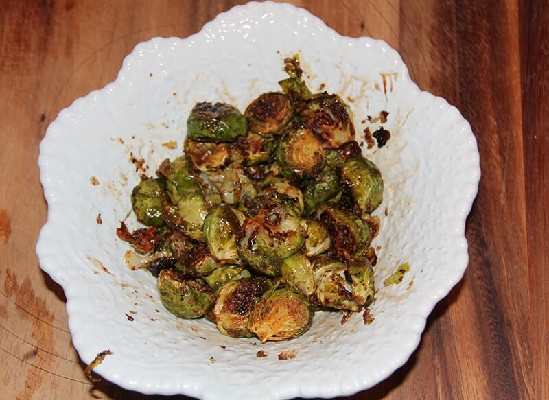A bowl full of roasted brussels sprouts.
