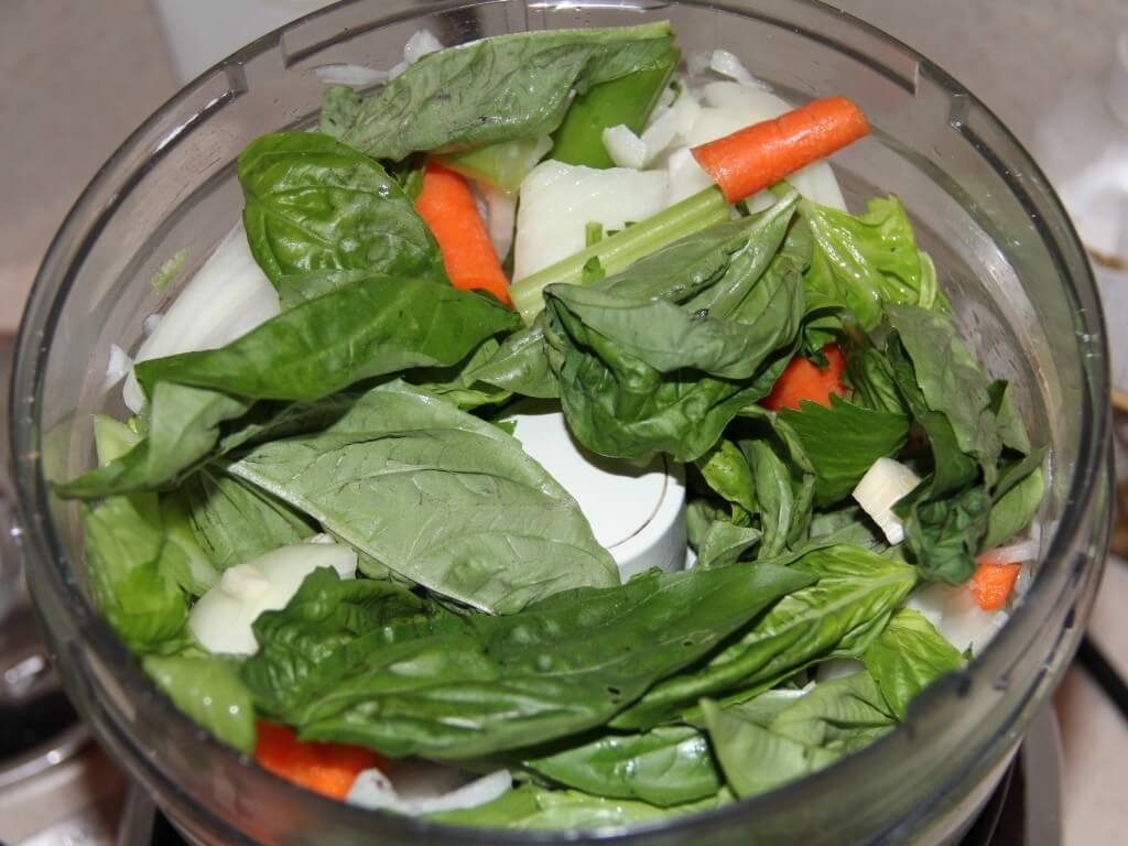 Basil, carrots, onion, and celery in food processor to make pestata.