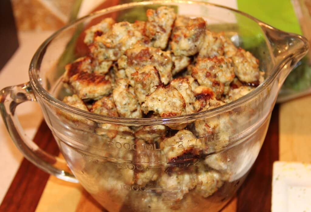 Chicken meatballs browned and in a bowl ready to add to Italian wedding soup.