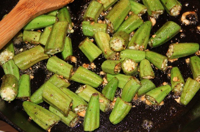 Sauteeing okra for honey cumin okra.