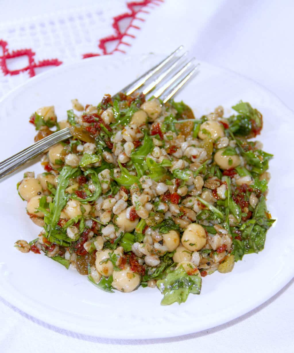 Farro Salad—a mix of farro, chickpeas, sun-dried tomatoes, arugula, and golden raisins, it hits all the right notes. Savory with just a touch of sweetness.