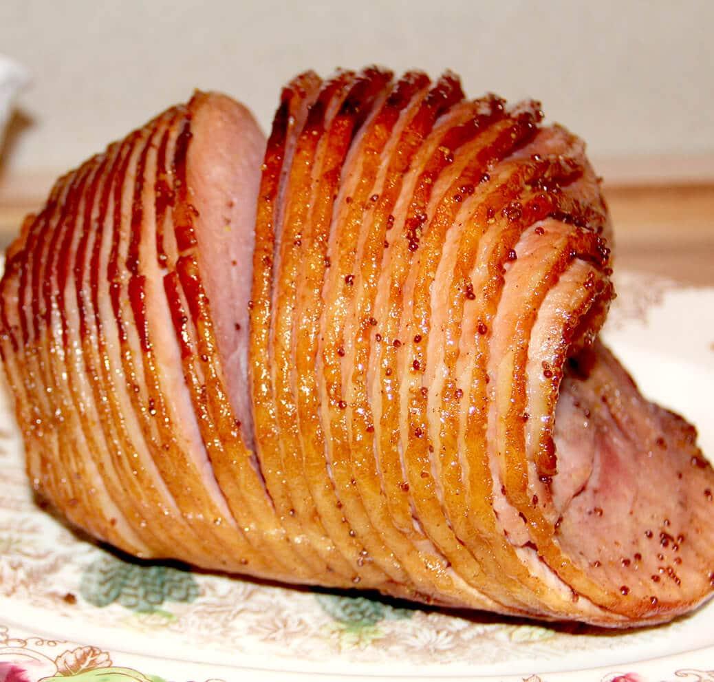 Baked ham with glaze on a platter.