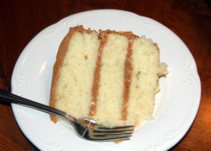slice of frosted caramel cake