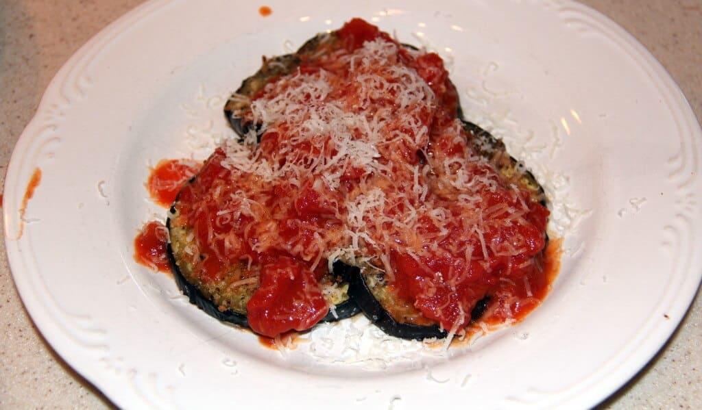 tomato sauce over eggplant
