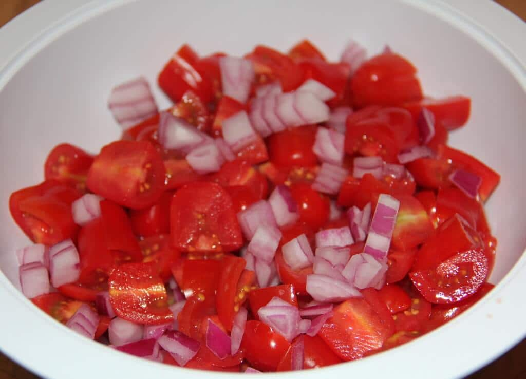 tomatoes and onions in a bowl