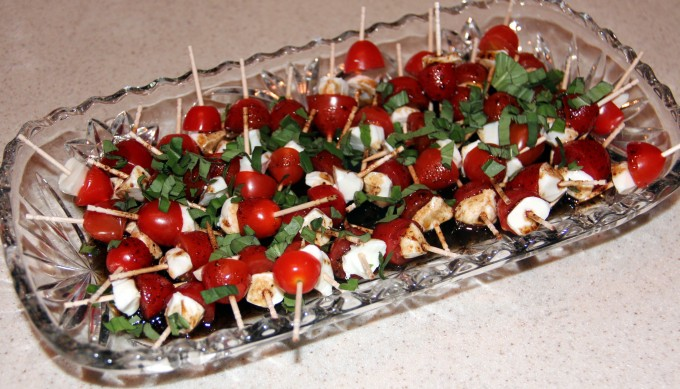 dish of caprese bites with tomatoes and mozzarella