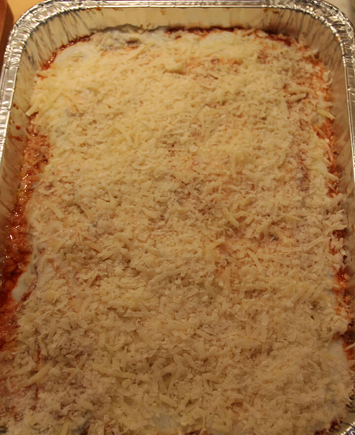 Cheese and bechamel sauce covering pasta for lasagna without ricotta.