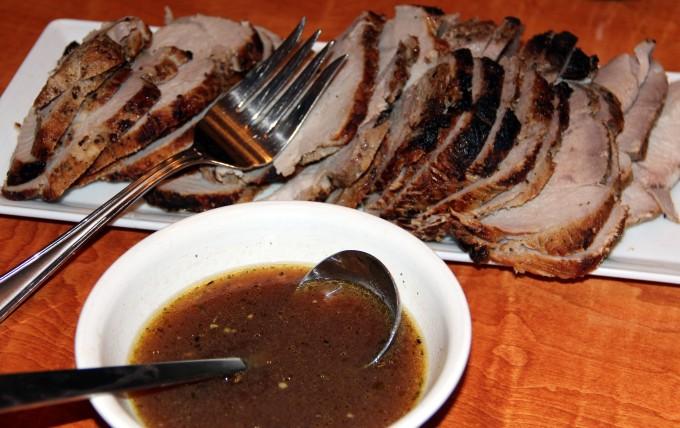 cider brined pork roast sliced on a platter
