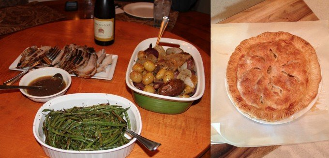 roast pork and apple pie and green beans on table