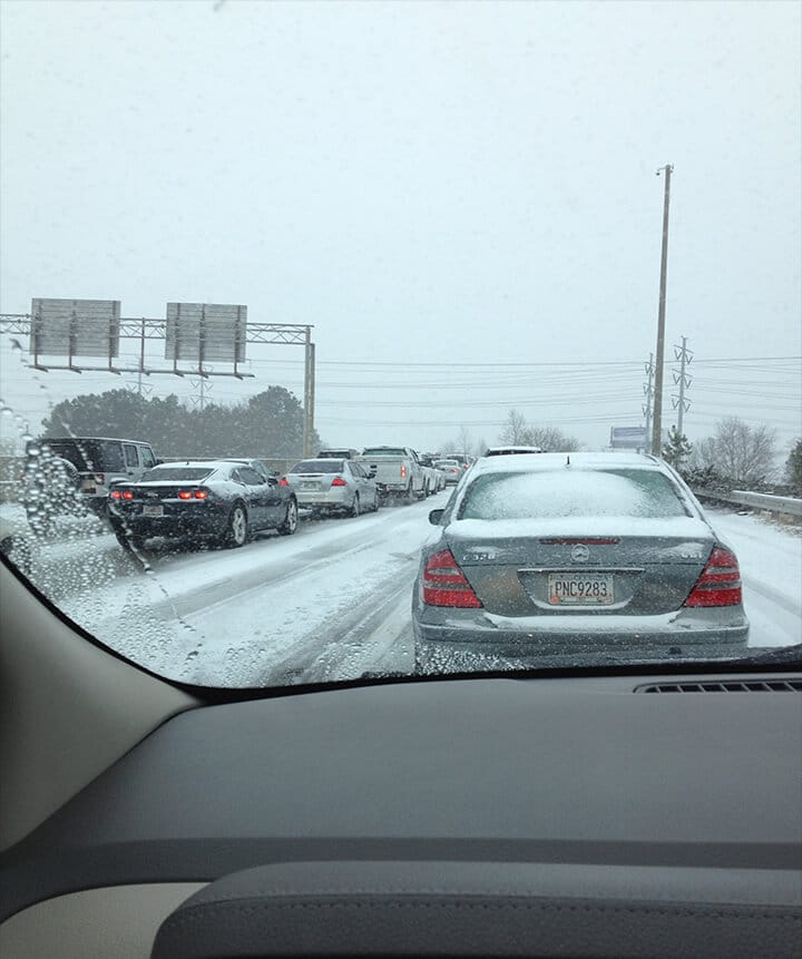 Cars stopped on the road for snowpocalypse atlanta.