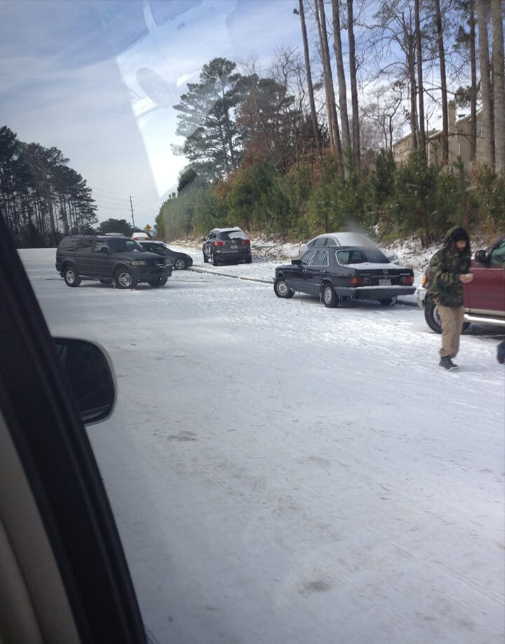 Abandoned vehicles on the side of the road after snowmageddon atlanta 2014.
