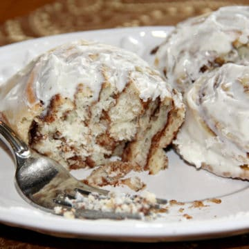 Easy homemade cinnamon rolls filled with brown sugar and cinnamon and covered with cream cheese icing!
