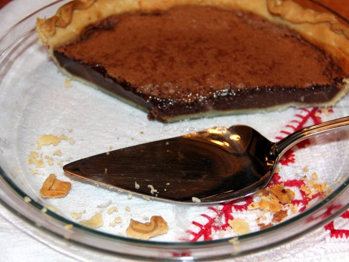 chocolate chess pie with slices removed