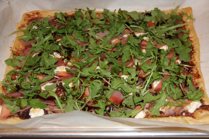 arugula and balsamic reduction drizzled over hot pizza