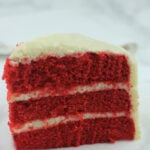 Red Velvet Cake with Cream Cheese Frosting made from an easy and moist red velvet cake recipe that will quickly become a family favorite! This Southern Red Velvet Cake is a classic for weddings, showers, and any event.