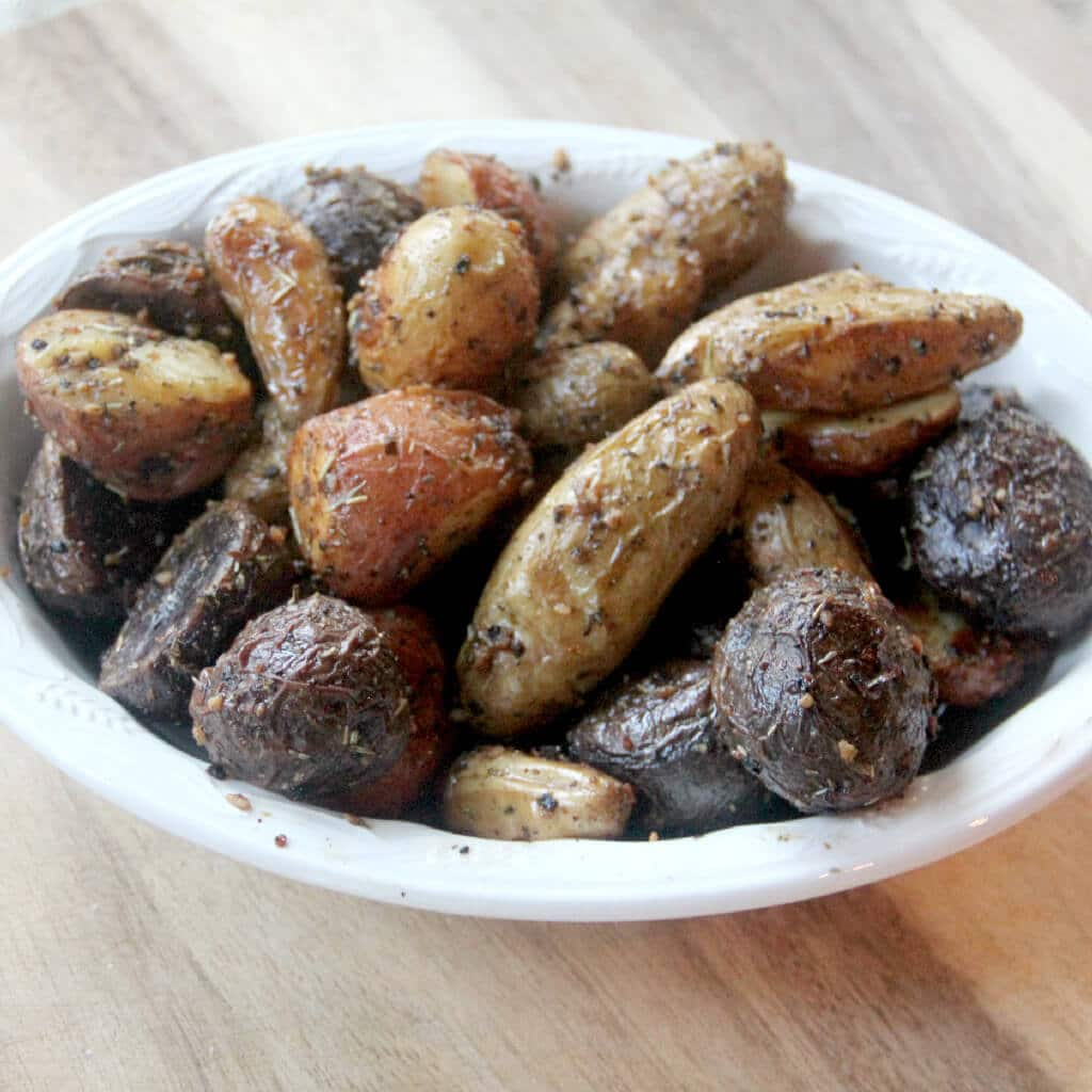 Roasted baby potatoes with garlic and Italian herbs are crispy on the outside and soft and fluffy on the inside. Easy to make!