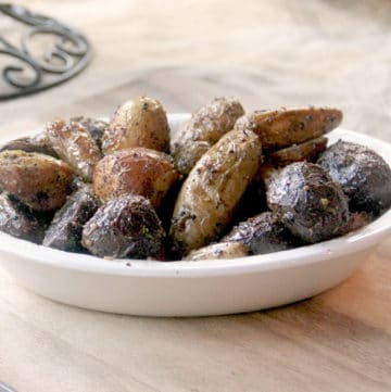 Roasted fingerling potatoes with garlic and Italian herbs are slightly crispy on the outside and soft on the inside and a choice accompaniment to almost any meal.