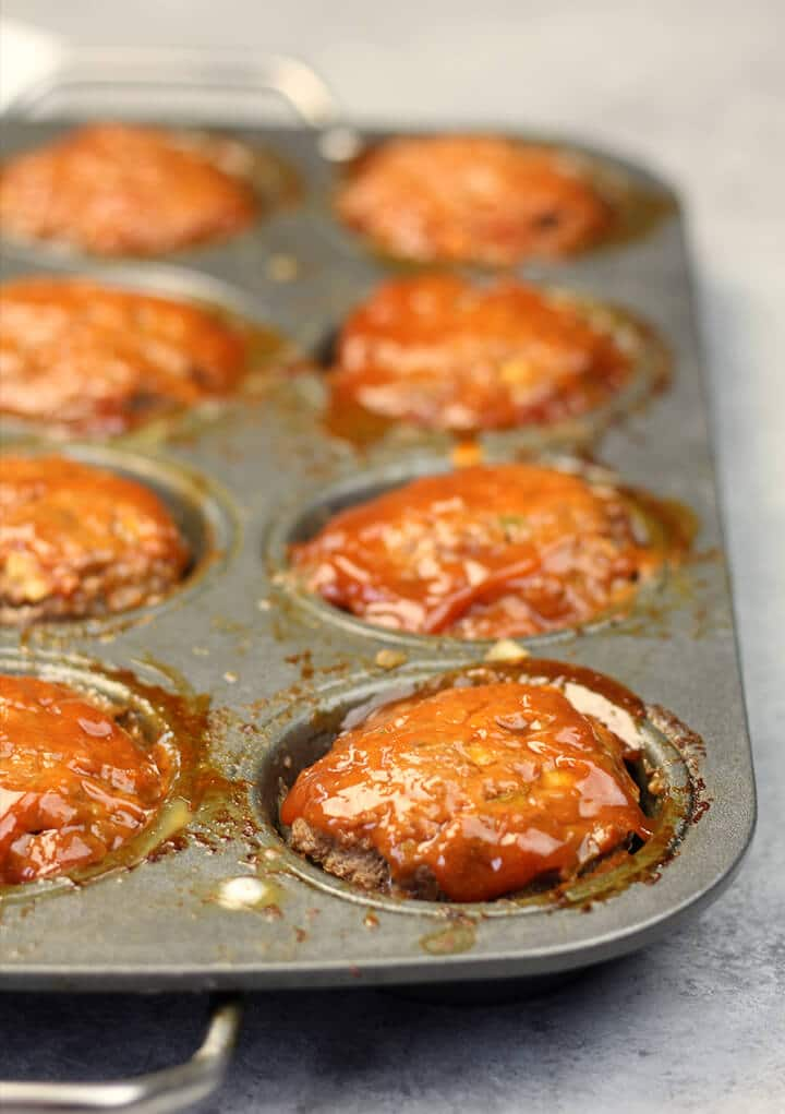 A muffin pan full of easy meatloaf muffins after they have baked.