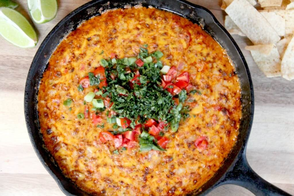pimento cheese queso fundido chorizo in a skillet