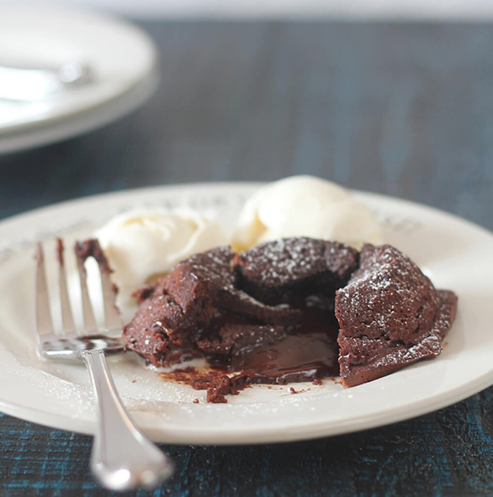 Chocolate Molten Lava Cake with bittersweet chocolate and cocoa has a luscious, gooey, chocolate center and can be made ahead! Perfect date night dessert!