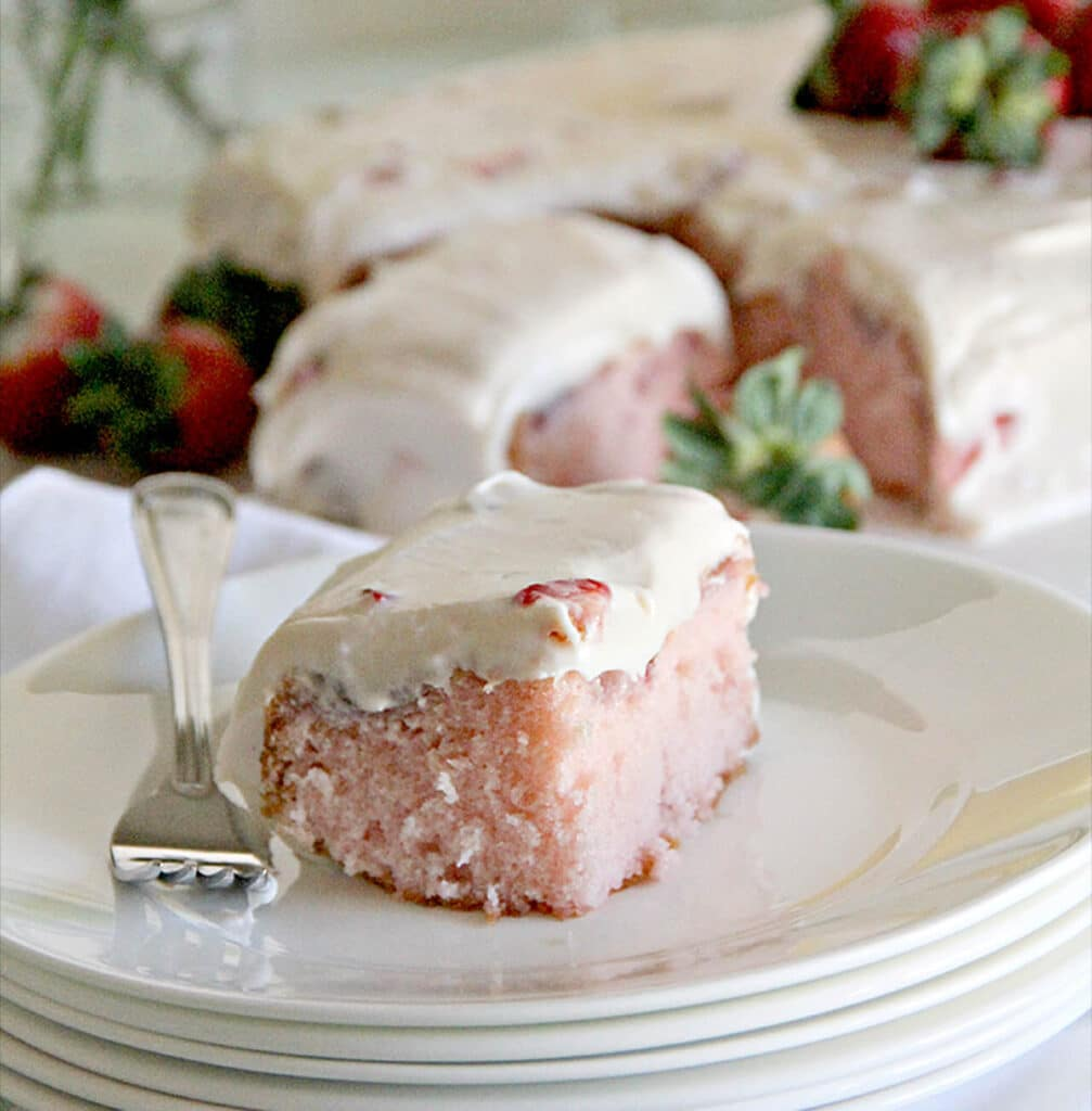 A luscious strawberry sheet cake with fresh strawberries and cream cheese frosting that's always a crowd-pleaser and easy to take along for potlucks.