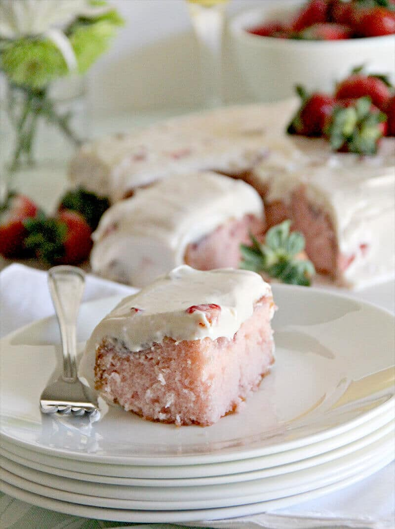 A luscious strawberry sheet cake with fresh strawberries and cream cheese frosting.
