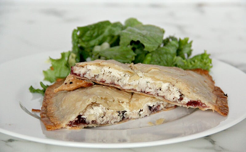 Side view of the inside of the baked leftover turkey hand pies.