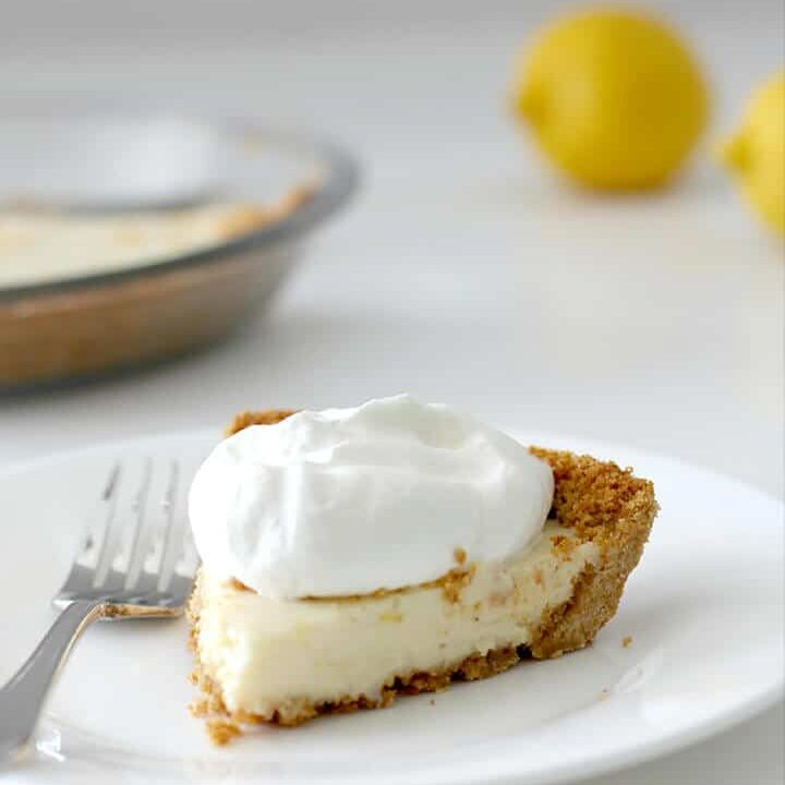A slice of lemon icebox pie on a plate.