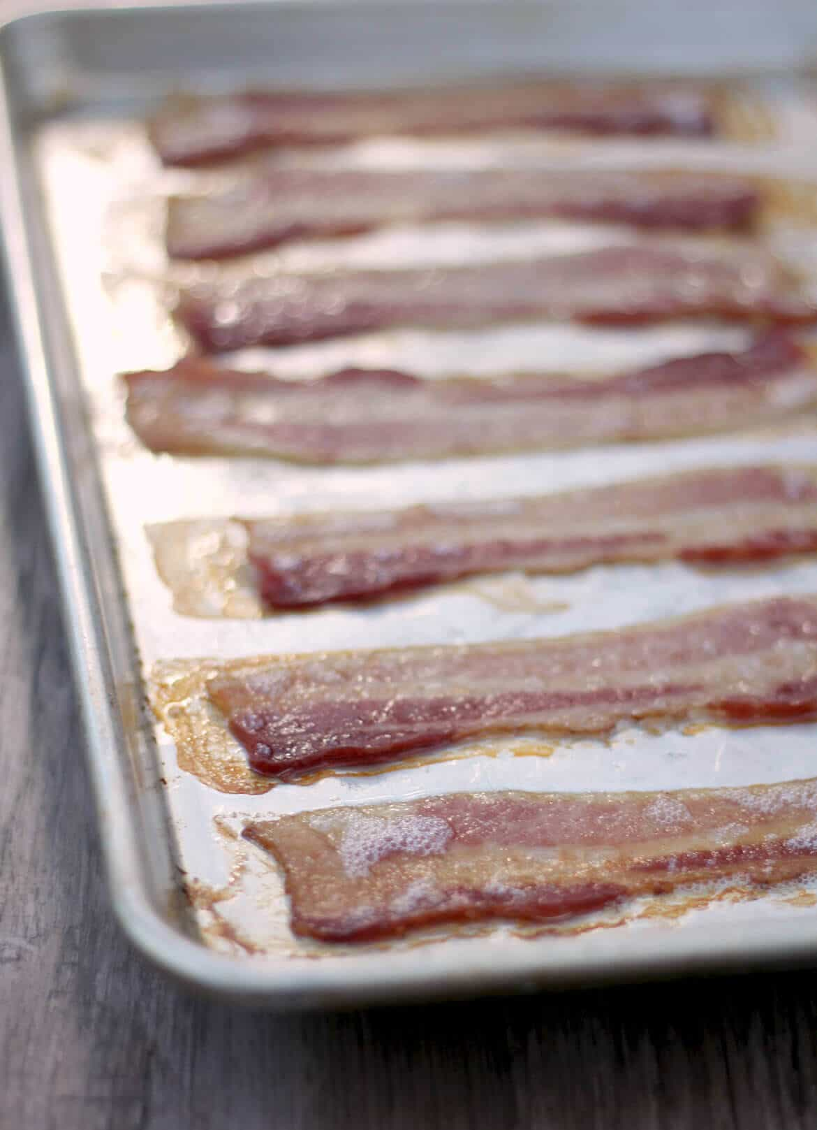 Oven cooked bacon is crisp and perfectly browned if done correctly! Forget the mess and standing over the skillet--oven cooking is the way to go!