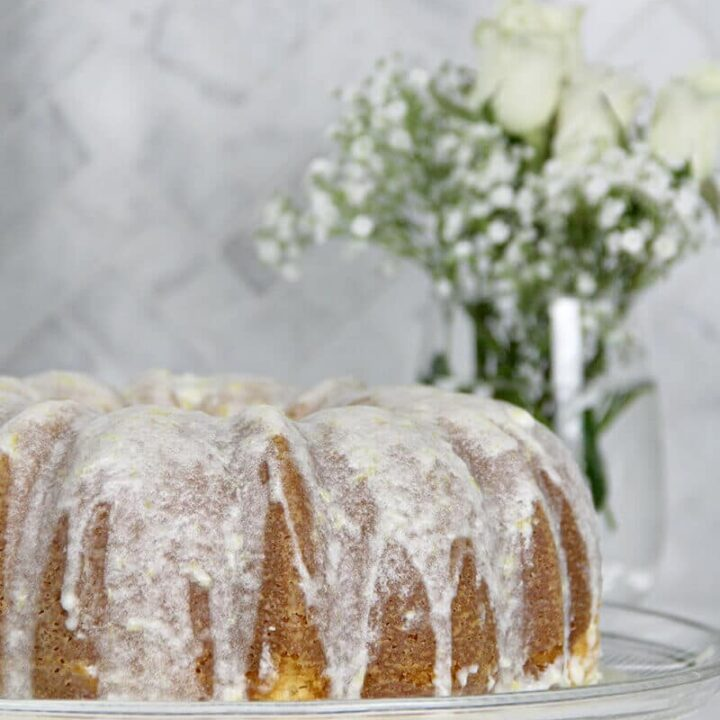 Easy Lemon Pound Cake with Lemon Glaze is a simple recipe using the Cream Cheese Pound Cake base and adding a zesty lemony glaze—it's fresh, pretty, and lip-smacking good!