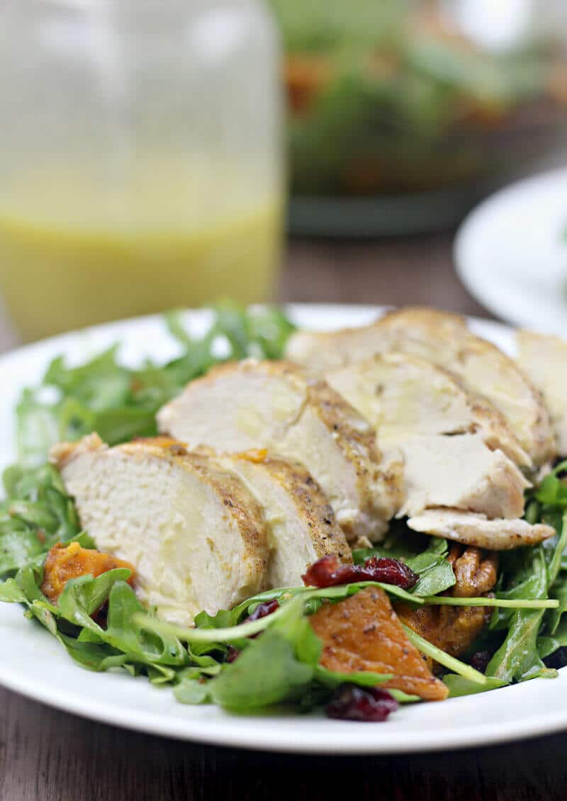 Arugula salad with roasted sweet potatoes, chicken, and honey-roasted pecans