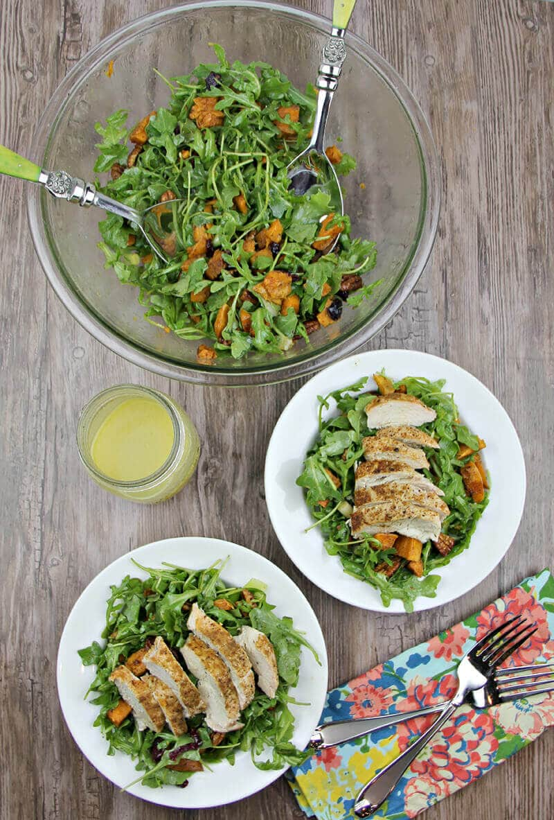 Arugula Salad with Sweet Potatoes and chicken on plates.