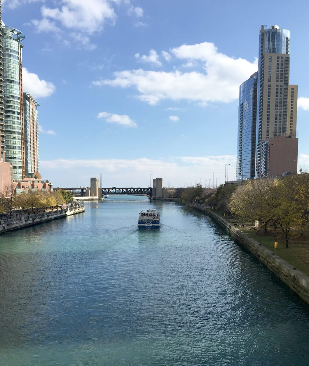 view of the chicago river with a boat