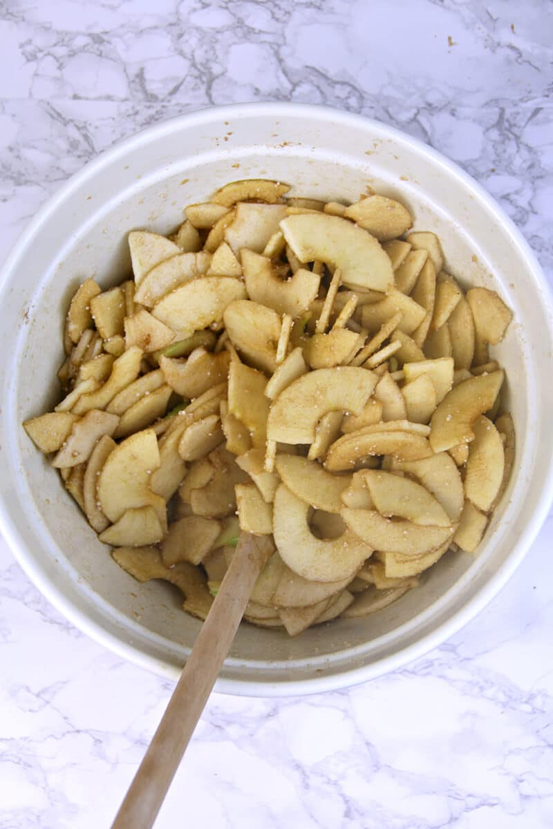 Mixing apples in bowl for Double-Crust Apple Pie.