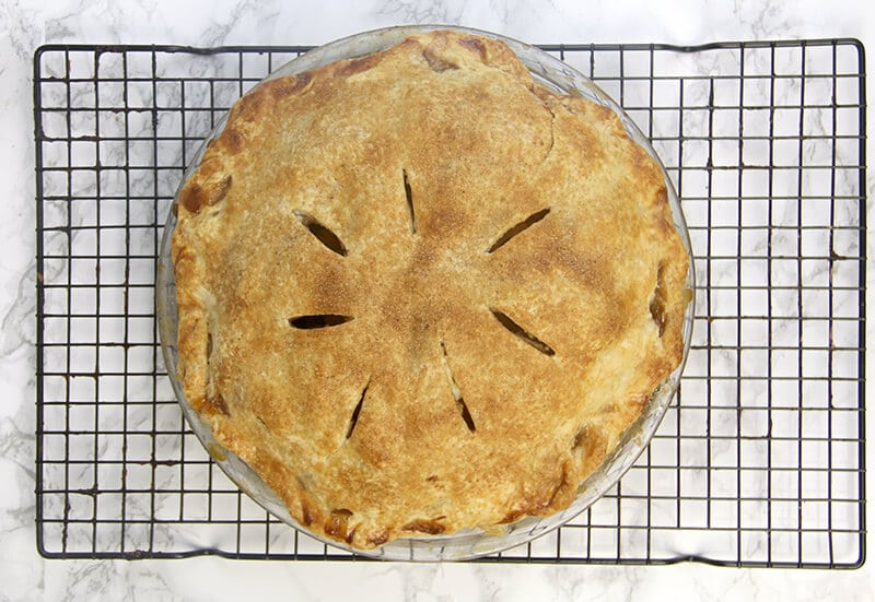 Double-Crust Apple Pie on cooling rack.
