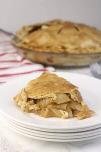 Double Crust Apple Pie slice on a plate.
