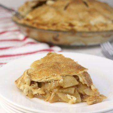Double Crust Apple Pie slice on a plate.