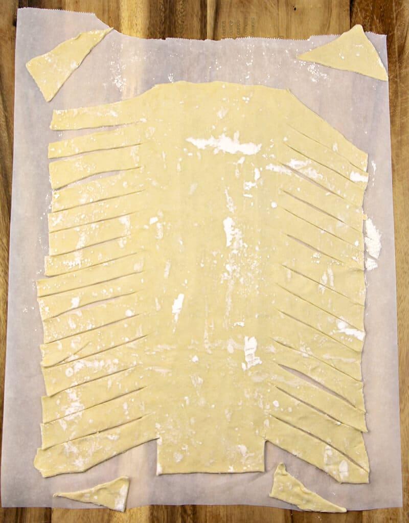 Dough cut into lattice strips for Easy Apple Strudel.
