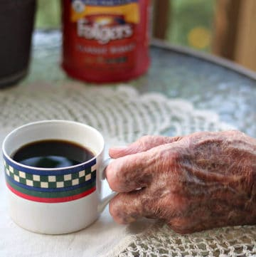 Veterans hand holding Folgers coffee.