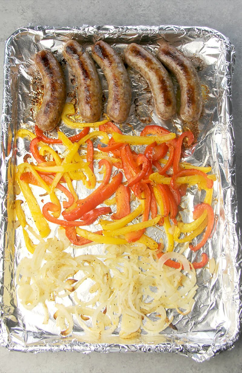Sausage, Peppers, and Onions on a large sheet pan.